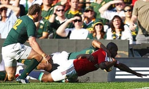 Ugo Monye heads for the line but was denied a try for the Lions against South Africa