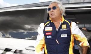 Renault Team Principal Flavio Briatore arrives to the British grand prix