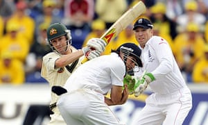 Australia's Michael Clarke hits a four that has Alastair Cook taking evasive action