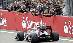 Red Bull's Mark Webber is cheered by his team after winning the German grand prix at the Nürburgring