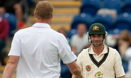 Australia's Philip Hughes smiles after ducking a bouncer from England's Andrew Flintoff