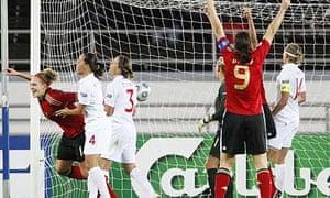 Kim Kulig, left, celebrates after scoring Germany's third goal against England.