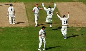 Durham celebrates the key wicket of Ally Brown