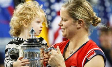 Kim Clijsters carries daughter Jada while holding the US Open trophy