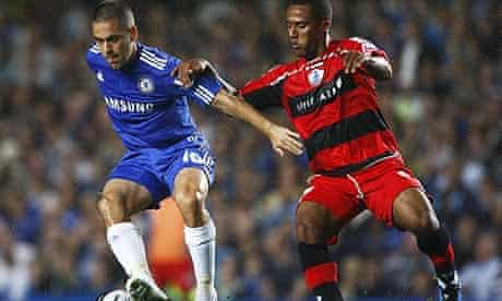 Joe Cole, left, is challenged for the ball by QPR's Wayne Routledge
