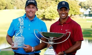 Phil Mickelson with the Tour Championship trophy beside Tiger Woods, with the FedEx Cup.