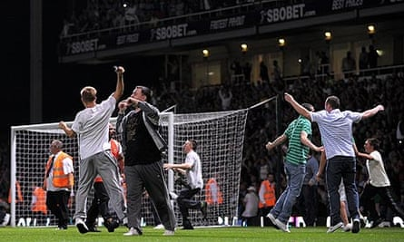 Supporters invade the pitch during last month's Carling Cup clash between West Ham and Millwall