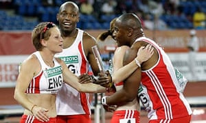 England's Mark Lewis-Francis and Marlon Devonish celebrate with Laura Turner and Katherine Endacott