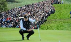 A huge crowd watch Ian Poulter line up a putt