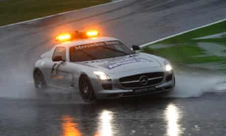 The safety car struggles through the rain in Suzuka