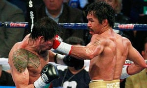 Antonio Margarito of Mexico is hit with a left by Manny Pacquiao in the fifth round of their fight