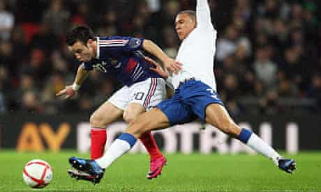 France's Mathieu Valbuena and Kieran Gibbs of England