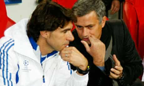 Real Madrid coach Jose Mourinho talks to Aitor Karanka