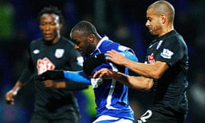 Ipswich's Jason Scotland holds off the attentions of West Brom's Steven Reid