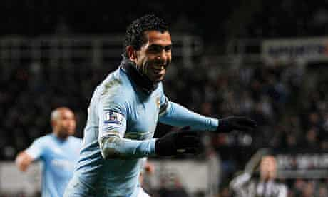 Carlos Tevez is all smiles after scoring Manchester City's third goal