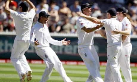 England celebrate the wicket of Michael Hussey