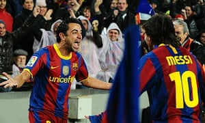 Xavi, left, and Lionel Messi are two of three Barcelona players shortlisted for the Ballon d'Or