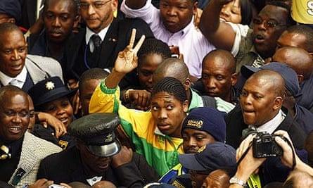 Caster Semenya arrives at Johannesburg airport in August 2009