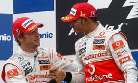 McLaren's Jenson Button congratulates Lewis Hamilton on his victory in the Turkish grand prix