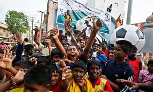 Football fans in Bangalore, Indian, celebrate the start of the World Cup 2010