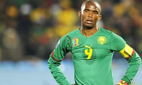 Cameroon's striker Samuel Eto'o (R) reac