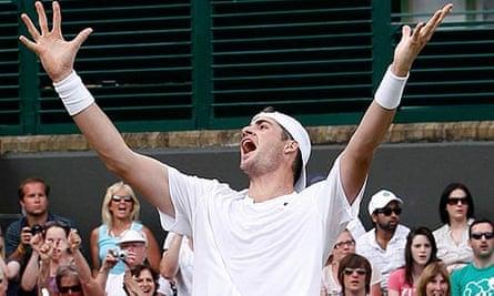 John Isner celebrates defeating Nicolas Mahut