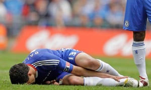 Michael Ballack, the Chelsea and Germany midfielder, lies on the turf after Boateng's tackle