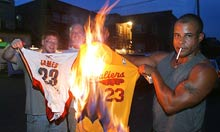 Cleveland Cavaliers fans set fire to LeBron James jerseys in Akron, Ohio