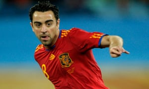 Spain's midfielder Xavi passes the ball