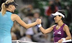 Maria Sharapova shakes hands with Kimiko Date Krumm