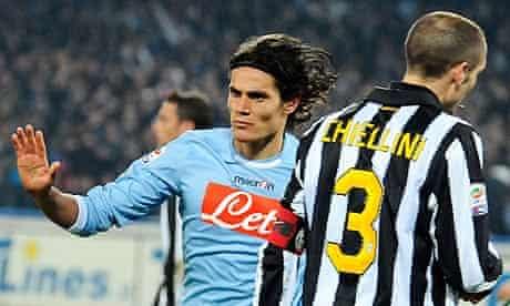 Edinson Cavani, left, passes Giorgio Chiellini as he celebrates scoring for Napoli against Juventus