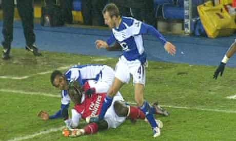 TV images appear to show Lee Bowyer, right, stamping on Bacary Sagna's knee