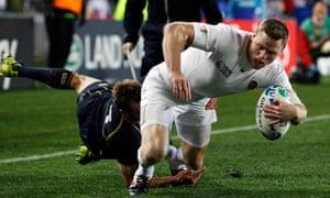 England's Chris Ashton crosses the line to score a try against Scotland