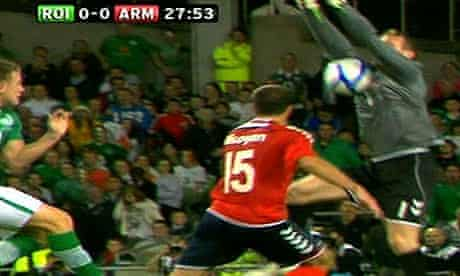Ireland's Simon Cox shoots at goal before Armenia goalkeeper Roman Berezovsky is shown a red card