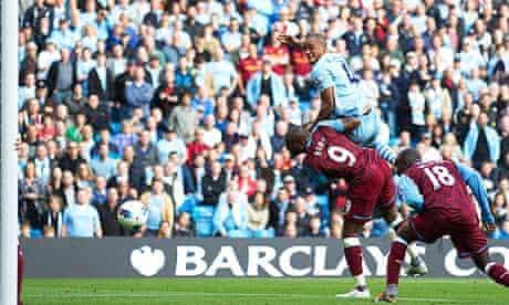 Manchester City's captain Vincent Kompany scores against Aston Villa