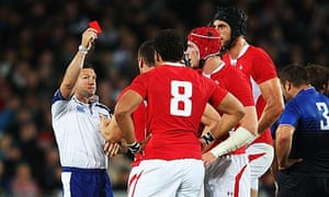 Referee Alain Rolland shows the red card to Sam Warburton