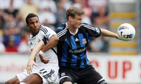 Swansea's Scott Sinclair battles with Robert Huth