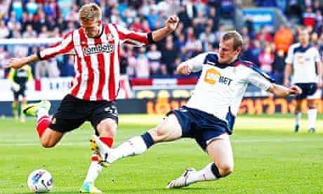 Sunderland's goalscorer Nicklas Bendtner, left, in action against Bolton Wanderer's David Wheater.