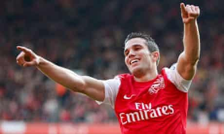 Arsenal's Robin van Persie celebrates scoring his second and Arsenal's third against Stoke