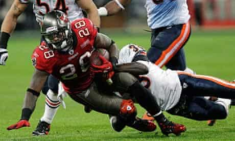 Tampa Bay's Kregg Lumpkin is taken down by the Chicago Bears