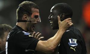 Steven Taylor, left, congratulates the Newcastle goalscorer Demba Ba