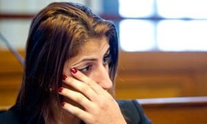 Female boxer Rola El-Halabi sits in a court room in Berlin