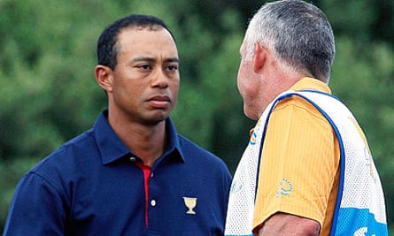 Tiger Woods shakes hands with former caddie Steve Williams after his Presidents Cup defeat