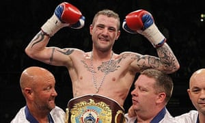 Ricky Burns celebrates victory against Michael Katsidis with his corner after the fight at Wembley.