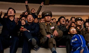 North Korean fans watch the World Cup qualifying match against Uzbekistan at the Yanggakdo Stadium