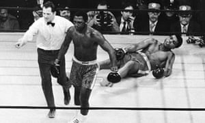Joe Frazier is directed to the ropes by referee Arthur Marcante after knocking down Muhammad Ali