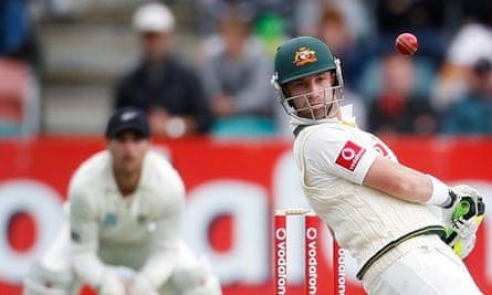 Australia's Hughes avoids a high ball