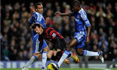David Silva of Manchester City is brought down by Jose Bosingwa and Ramires of Chelsea