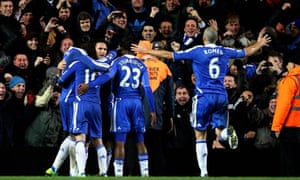 Frank Lampard is mobbed by team-mates