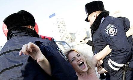 Ukrainian police arrest topless protester
